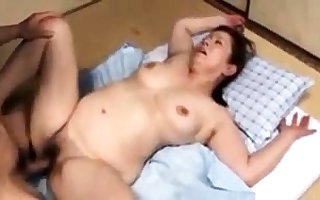 Japanese matured hooker surrounding a entertaining bosom illusion hot
